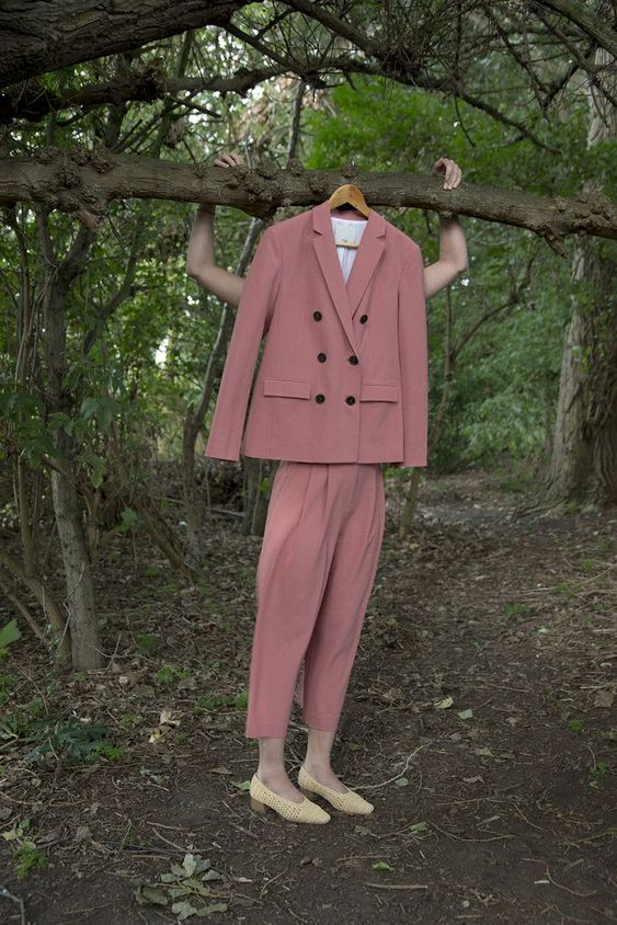 Women's Pink Suit Hanging From Tree