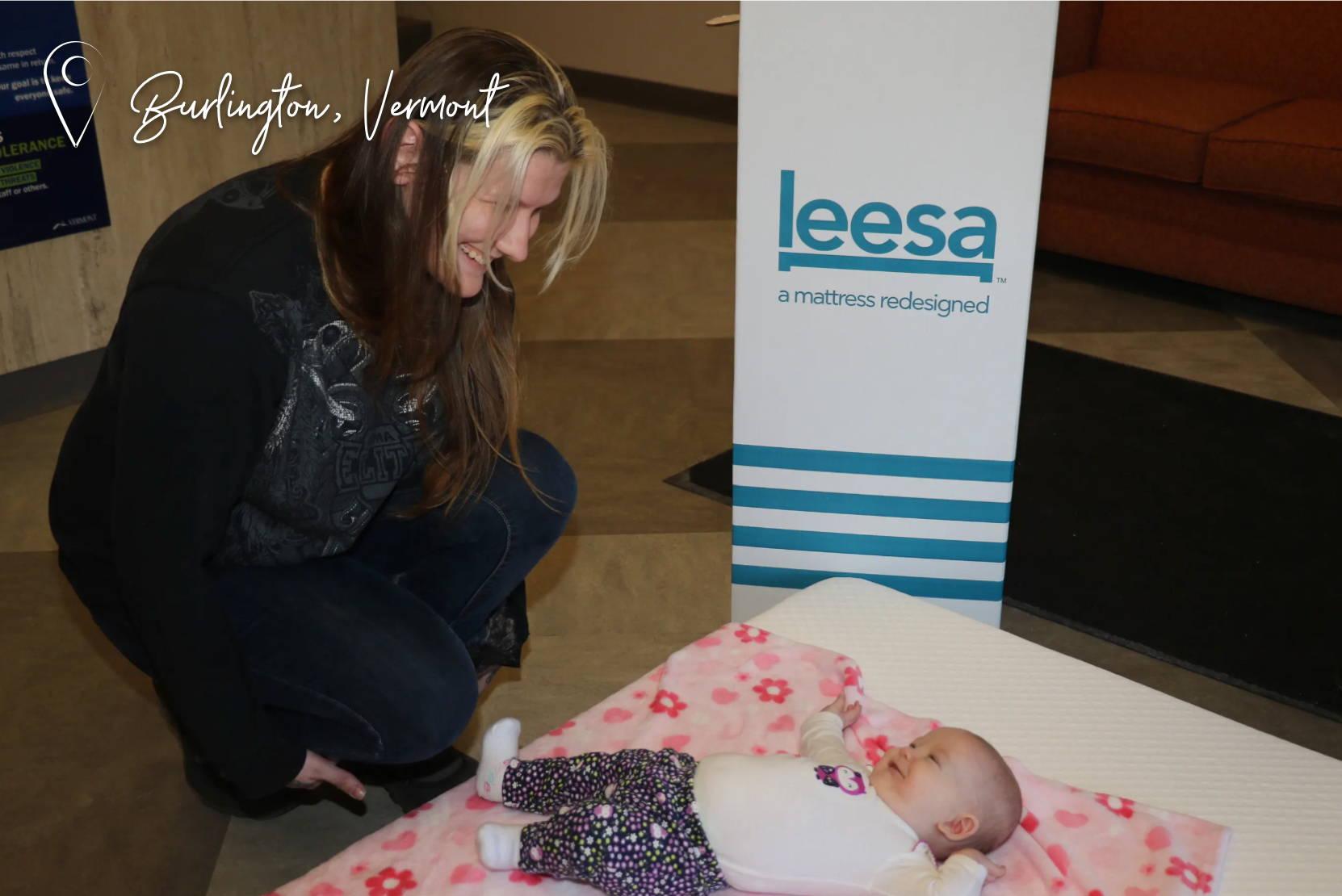 Burlington, Vermont, women leaning over baby laying on Leesa mattress