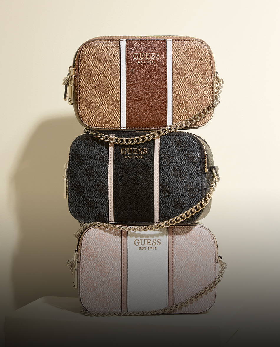 a stack of 3 GUESS handbags in black, rose and brown with GUESS logo's