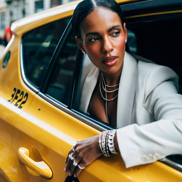 Model leaning out of taxi wearing Ring Concierge jewelry