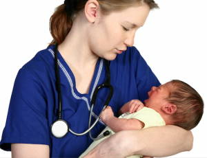 Midwife Holding A Baby