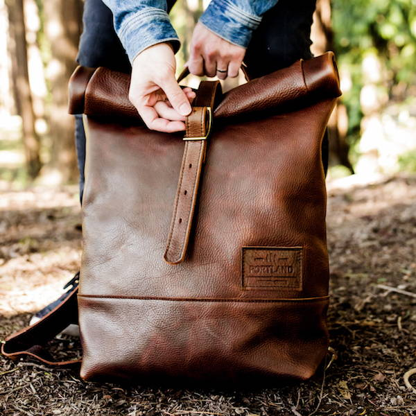 cold brew leather rolltop backpack being buckled