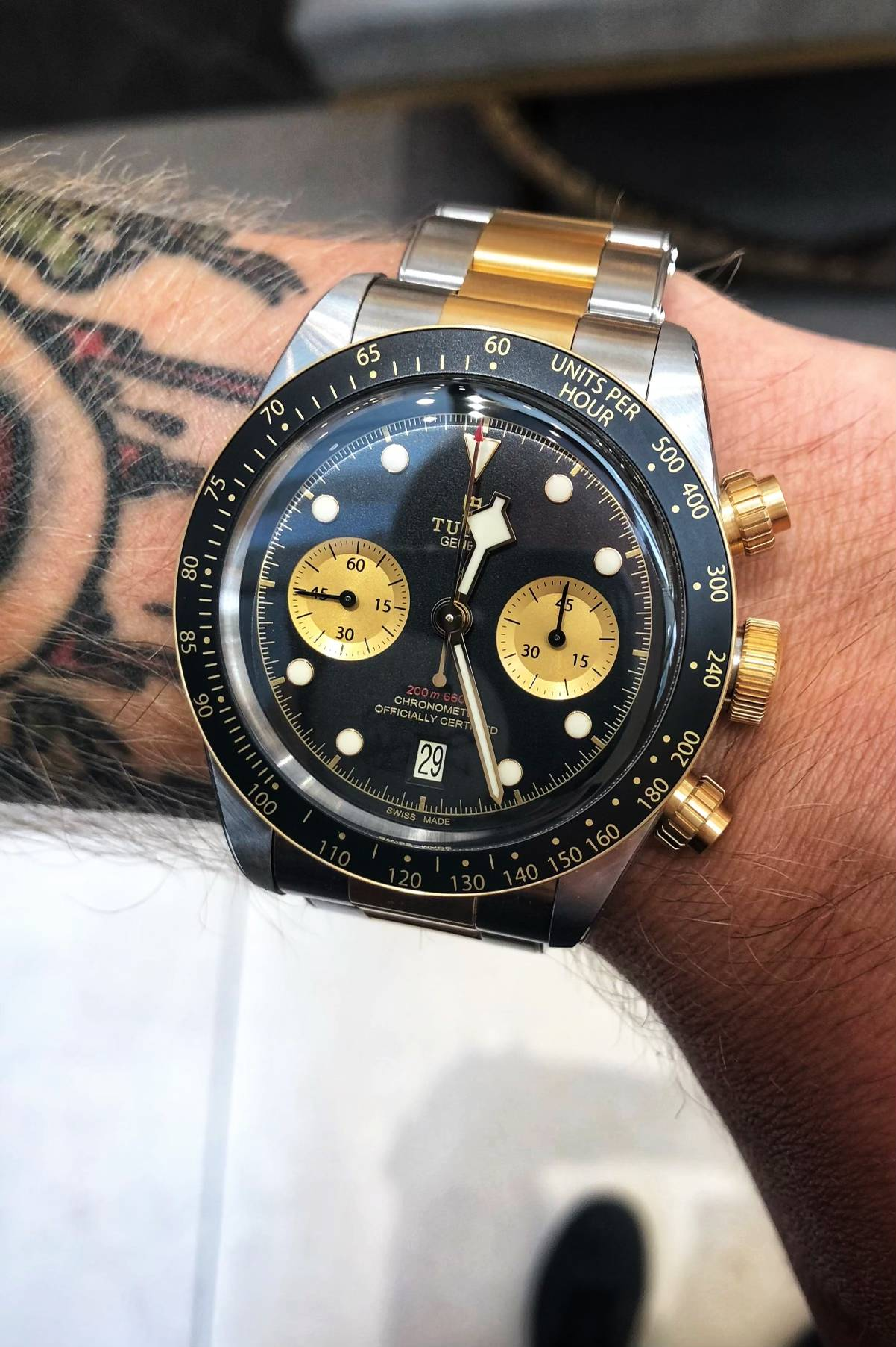 Tudor black bay black and gold watch