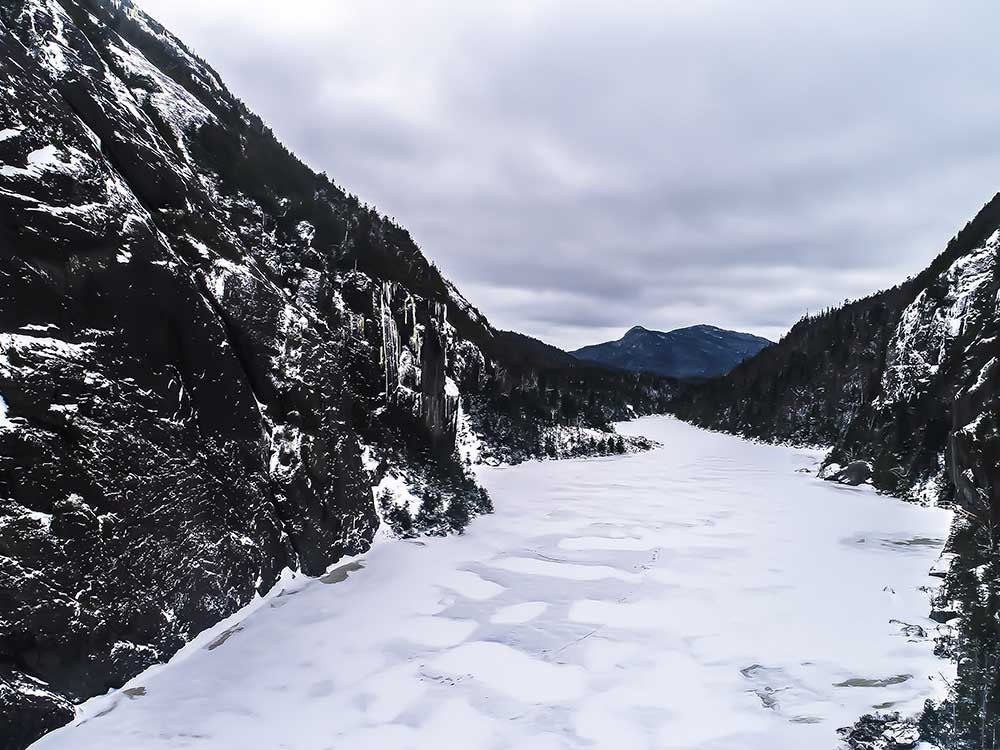 Winter at avalanche lake when the lake is frozen over