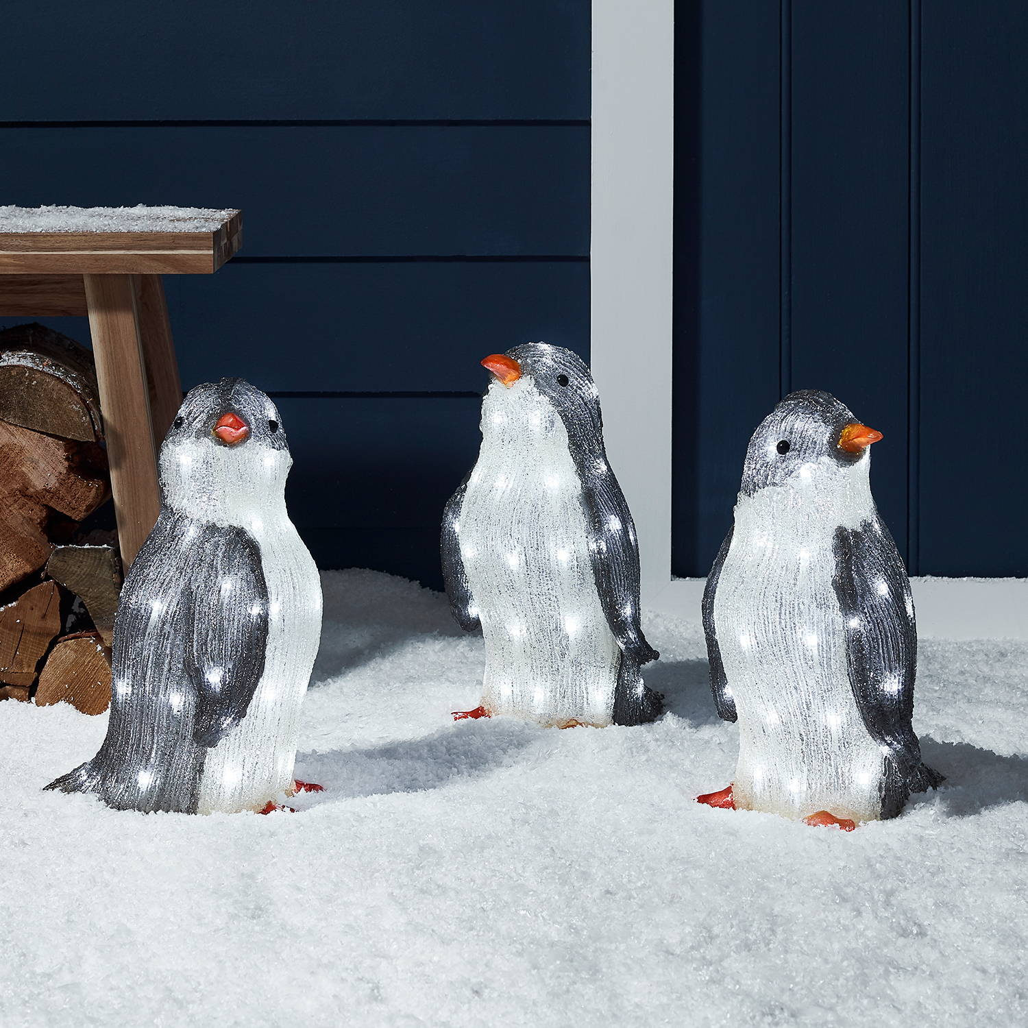 Trio of acrylic penguin Christmas Figures in the snow