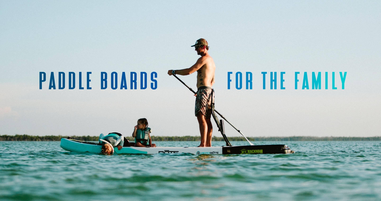 Man on Rackham Aero Paddle Board with kids