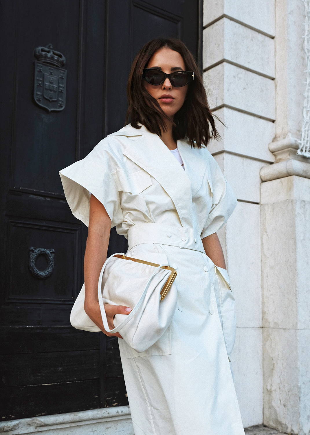 Debora Rose wearing Oroton Celia Clutch in White