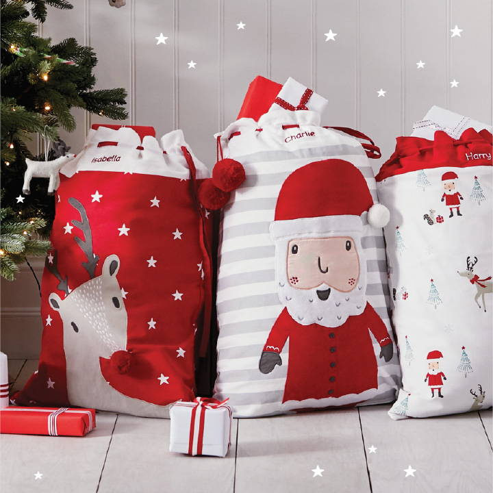 Set of three Christmas sacks filled with presents. Includes reindeer, Father Christmas and christmas eve designs.