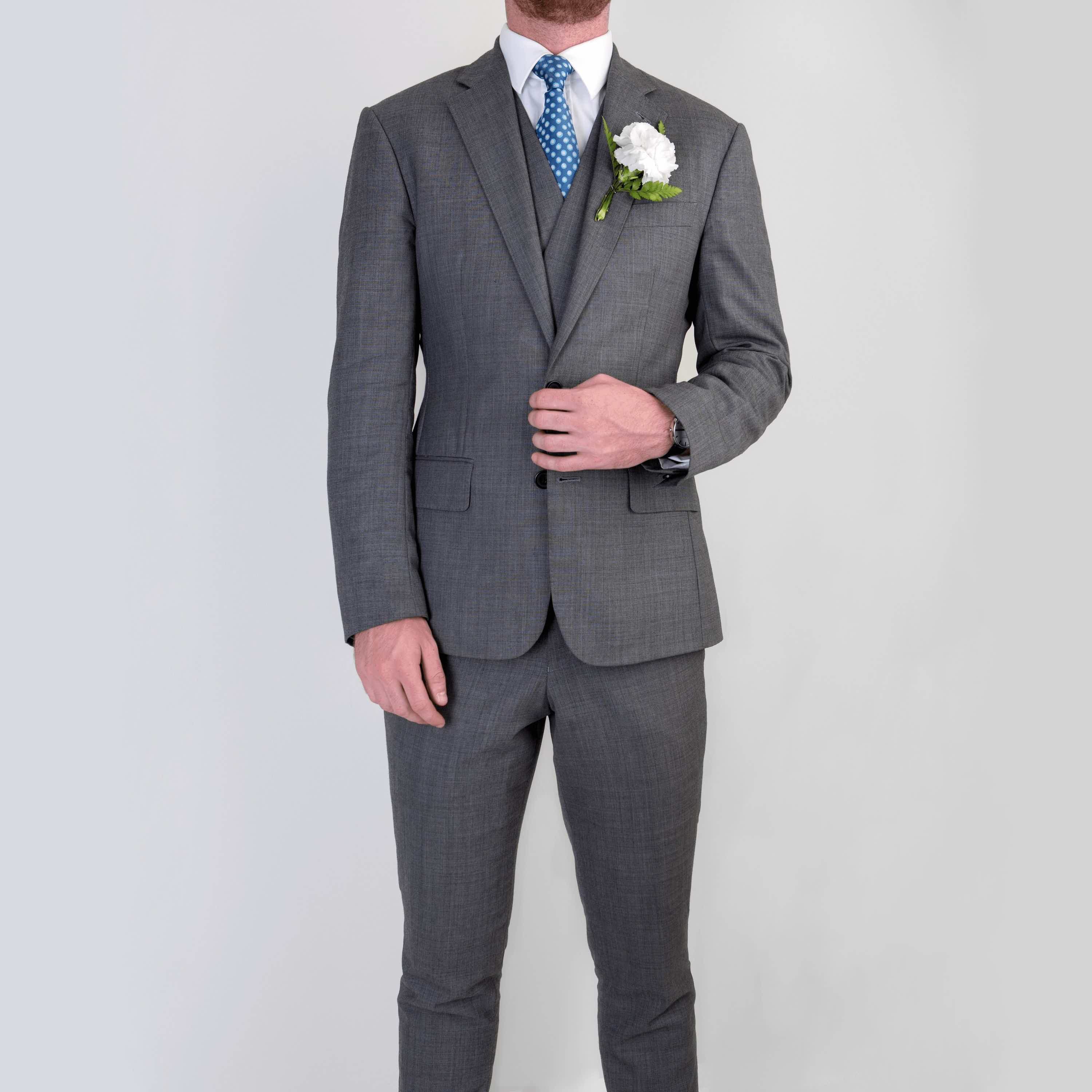 Bespoke three piece wedding suit with waistcoat tailored by Mullen and Mullen