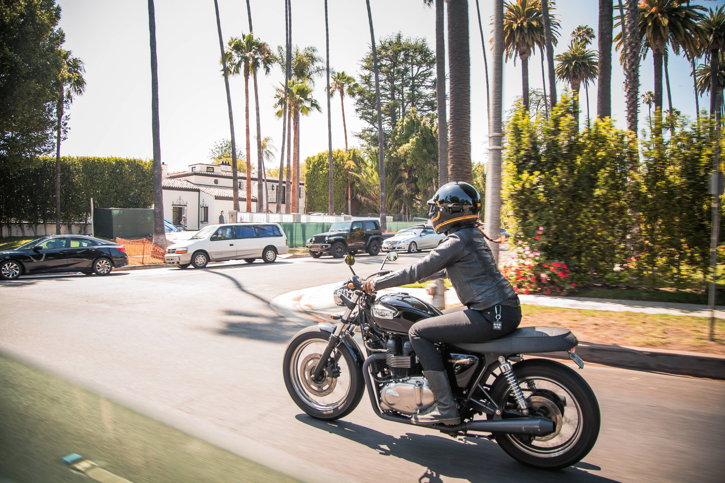 Sam cruising town on her Triumph Bonneville with bits from British Customs