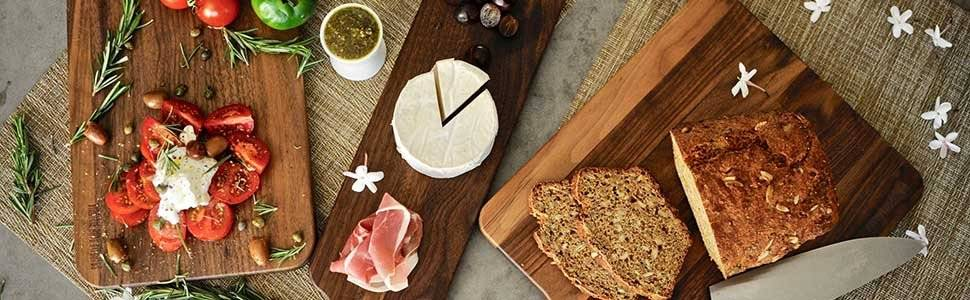 Walnut cutting boards from Virginia Boys Kitchens presented with breads, cheeses, meats tomatoes and more