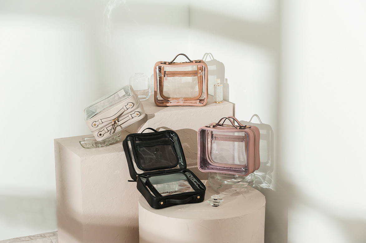 CALPAK Clear Cosmetics Case in Stone, Caramel, Black, and Mauve.