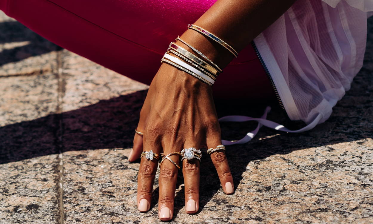 Model wearing various Ring Concierge rings and bangles
