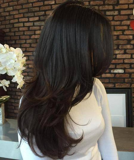 Style you long layered into wavy hairstyle