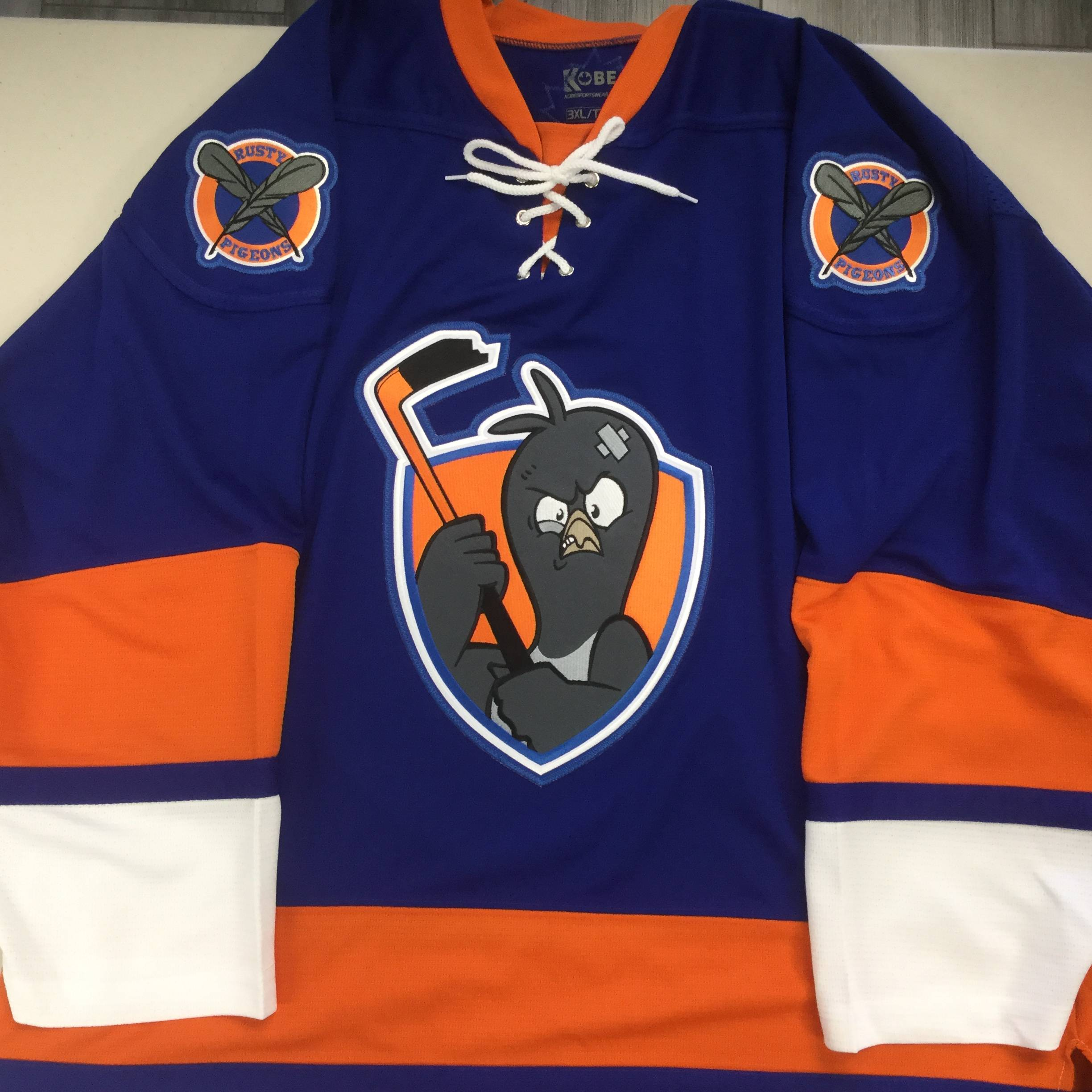 Custom Hockey Jersey With Embroidered Twill Crest on Kobe K3G50A New York Islanders Blue: Rusty Pigeons