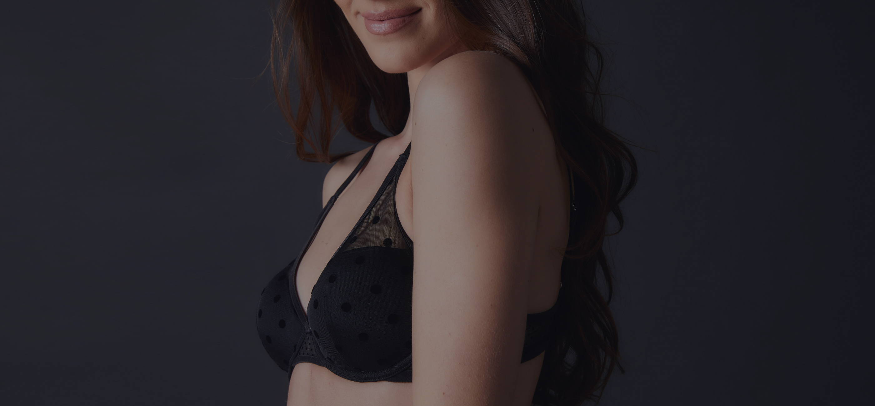 Woman wearing the Journelle Valentina Black polka dot bra that is on sale for 30% off