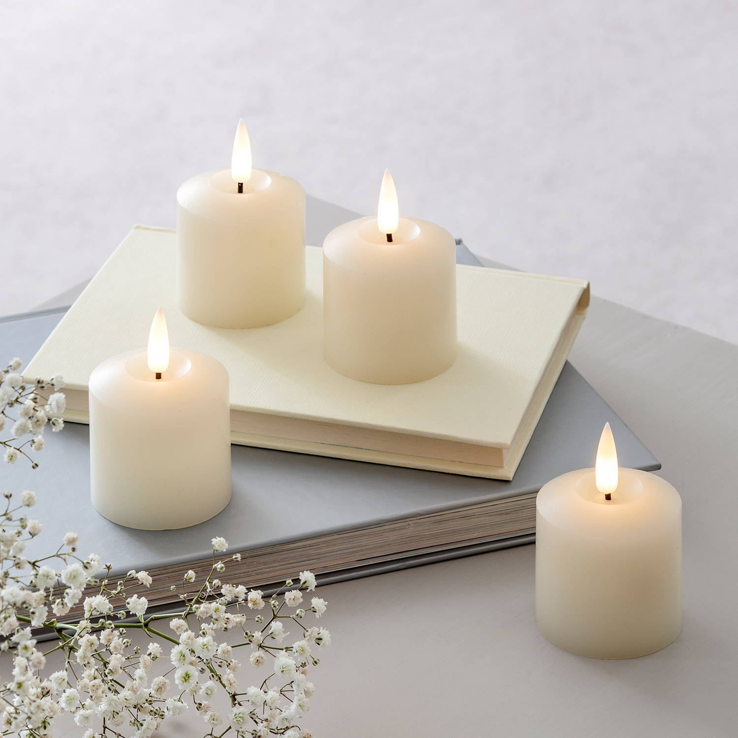 4 small TruGlow votive LED candles
