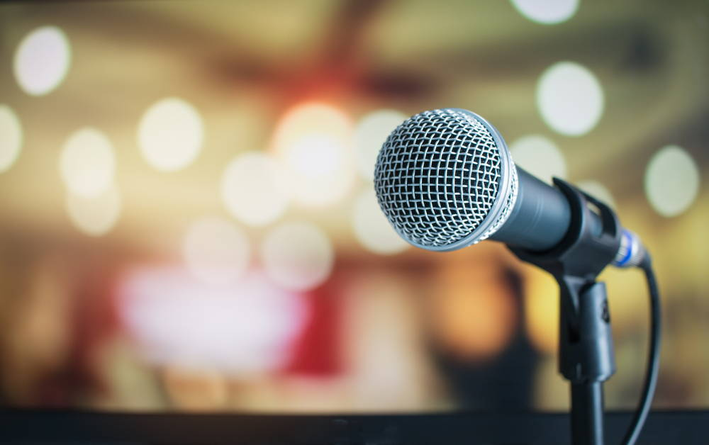 microphone against blurred lights background