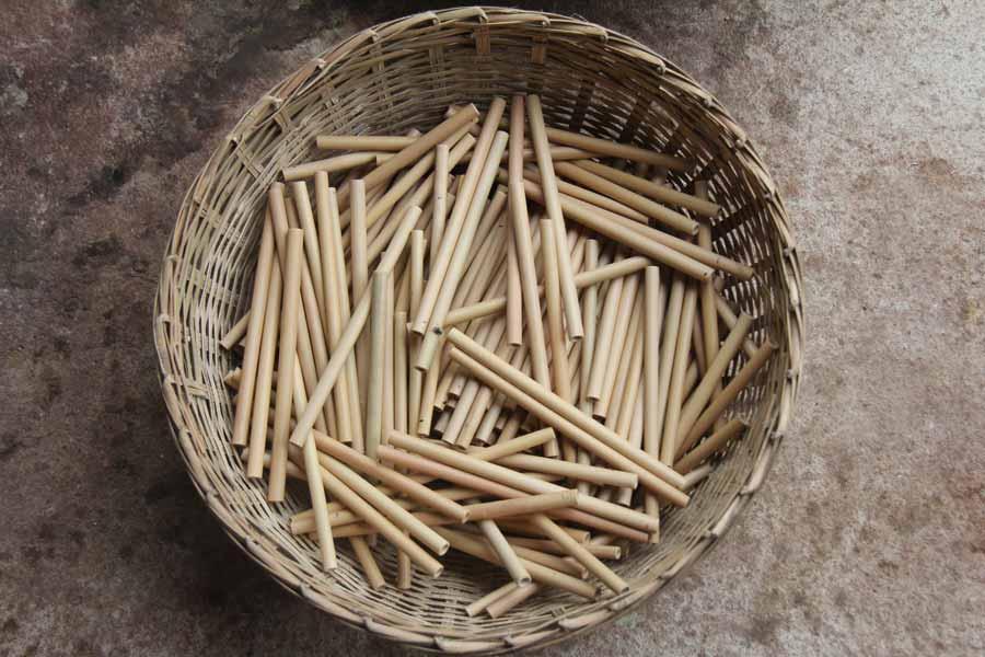 Bamboo straws nestled in woven basket