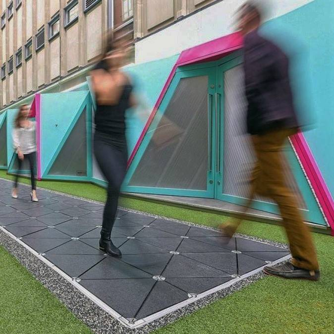 Pedestrians walking on energy harvesting tiles