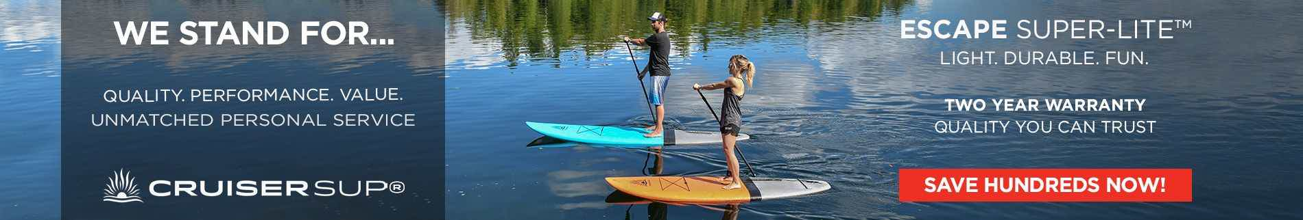 A young couple stand up paddle boarding