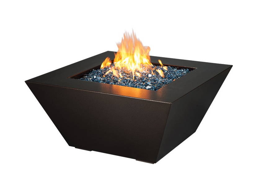 A steel fire pit ignited