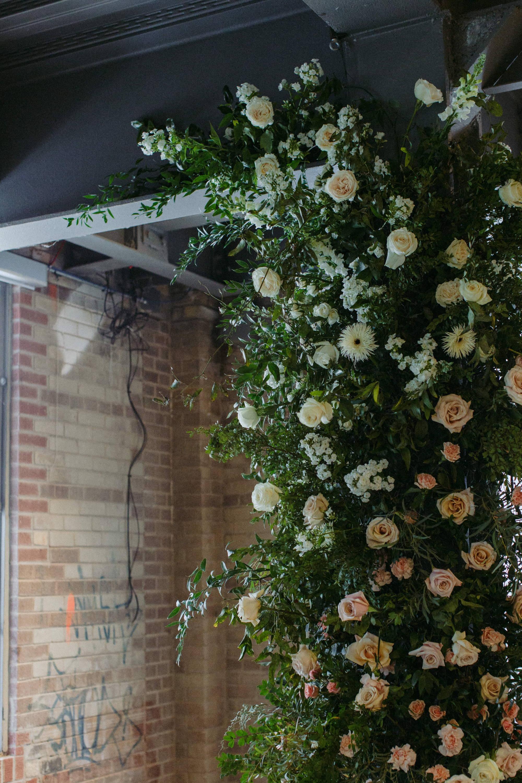 Floral arch installation at Evergreen Brickworks