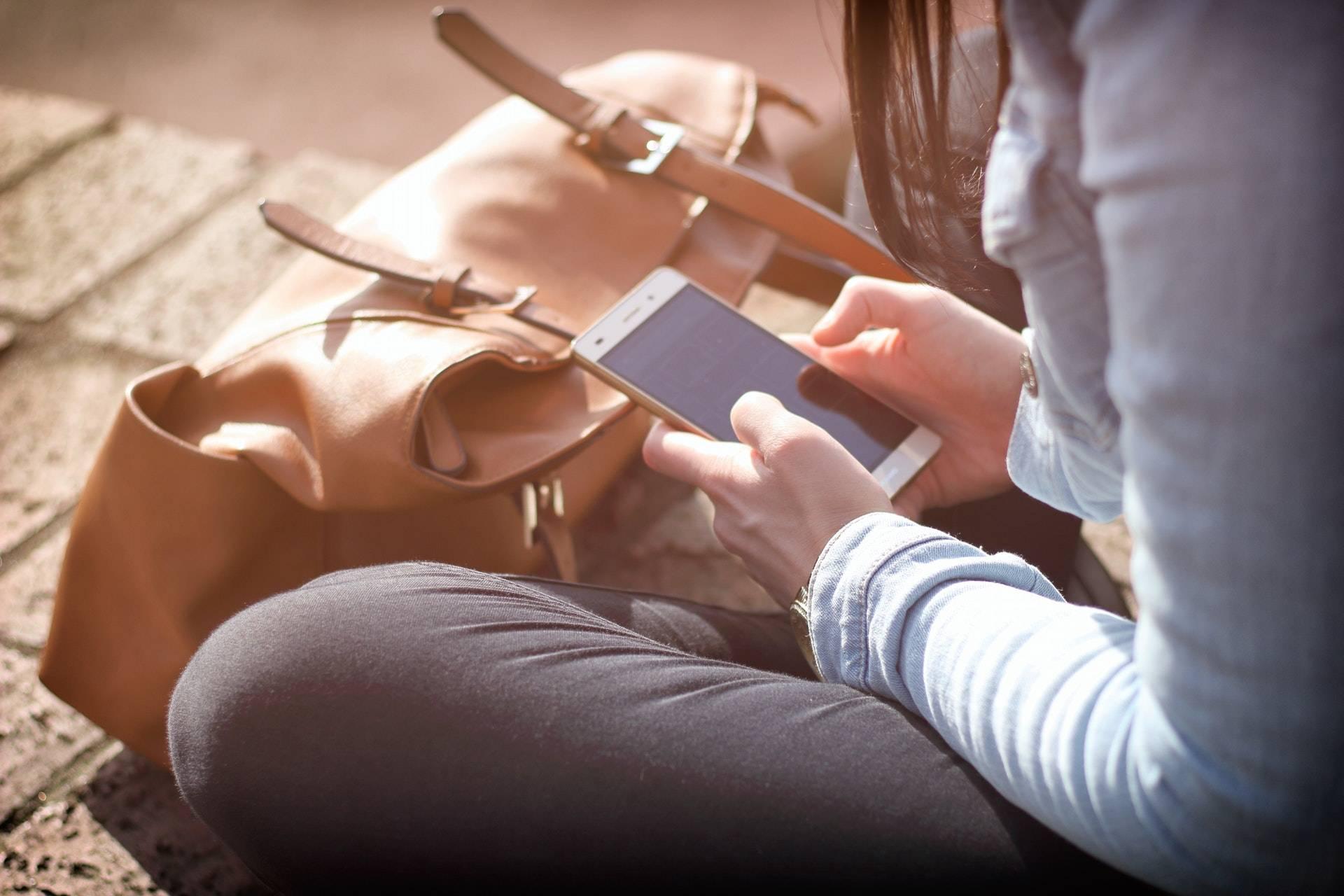 Woman using app for PAX 3 vaporizer