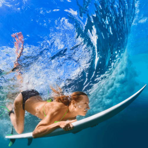 Surfers Duck Diving Under The Water