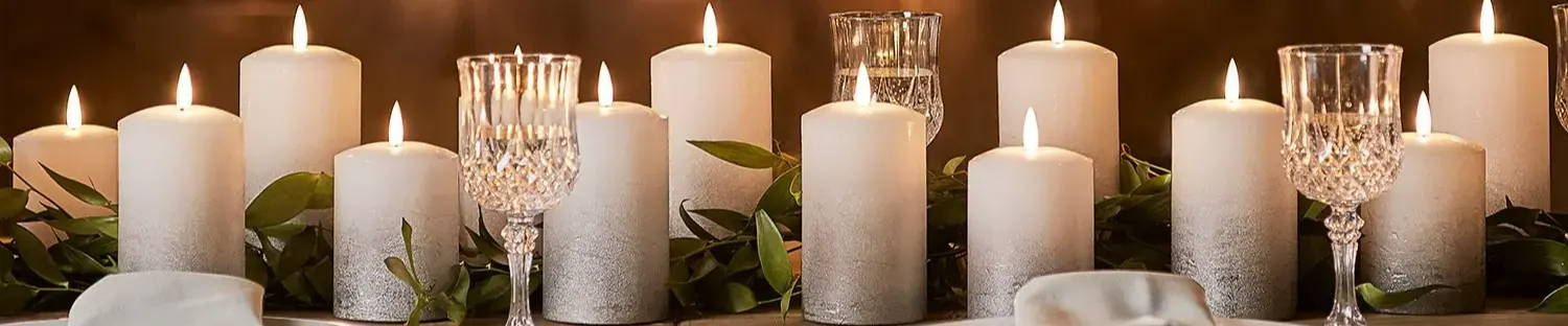Silver ombre TruGlow candles styled on table at differing heights