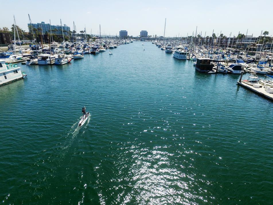 Paddling the Cadence racing board in Venice California