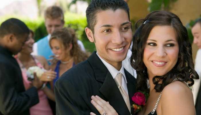 Teen couple posing at school dance