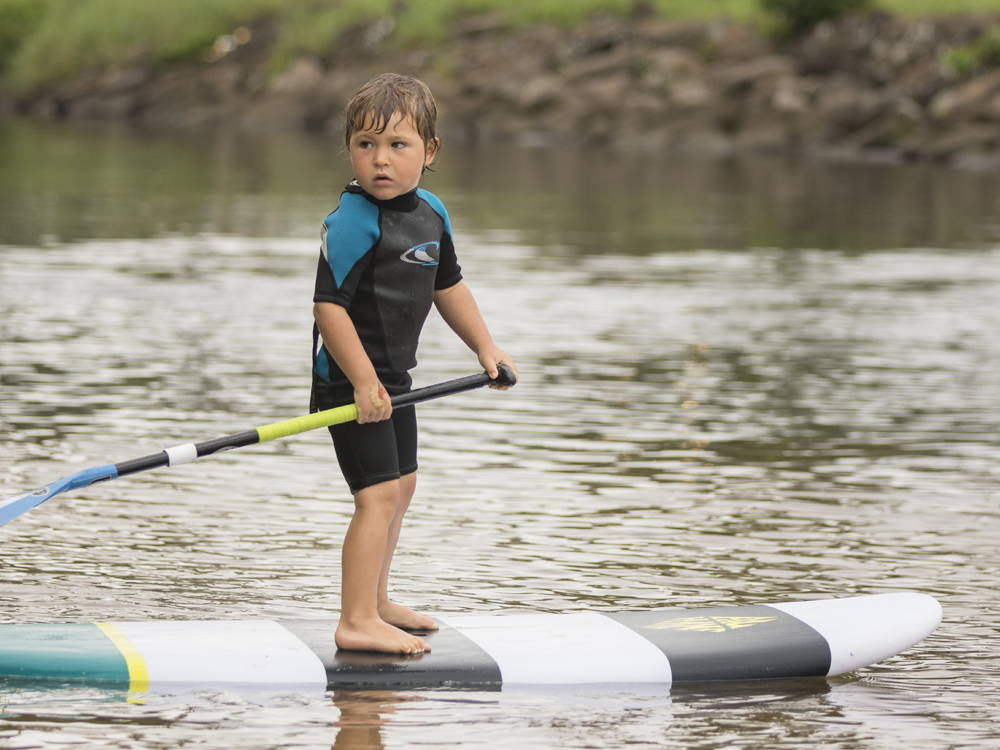 Kid paddling the Grom SUP