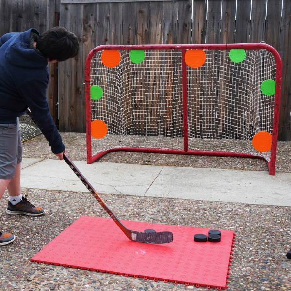 Magnetic shooting targets on hockey goal net