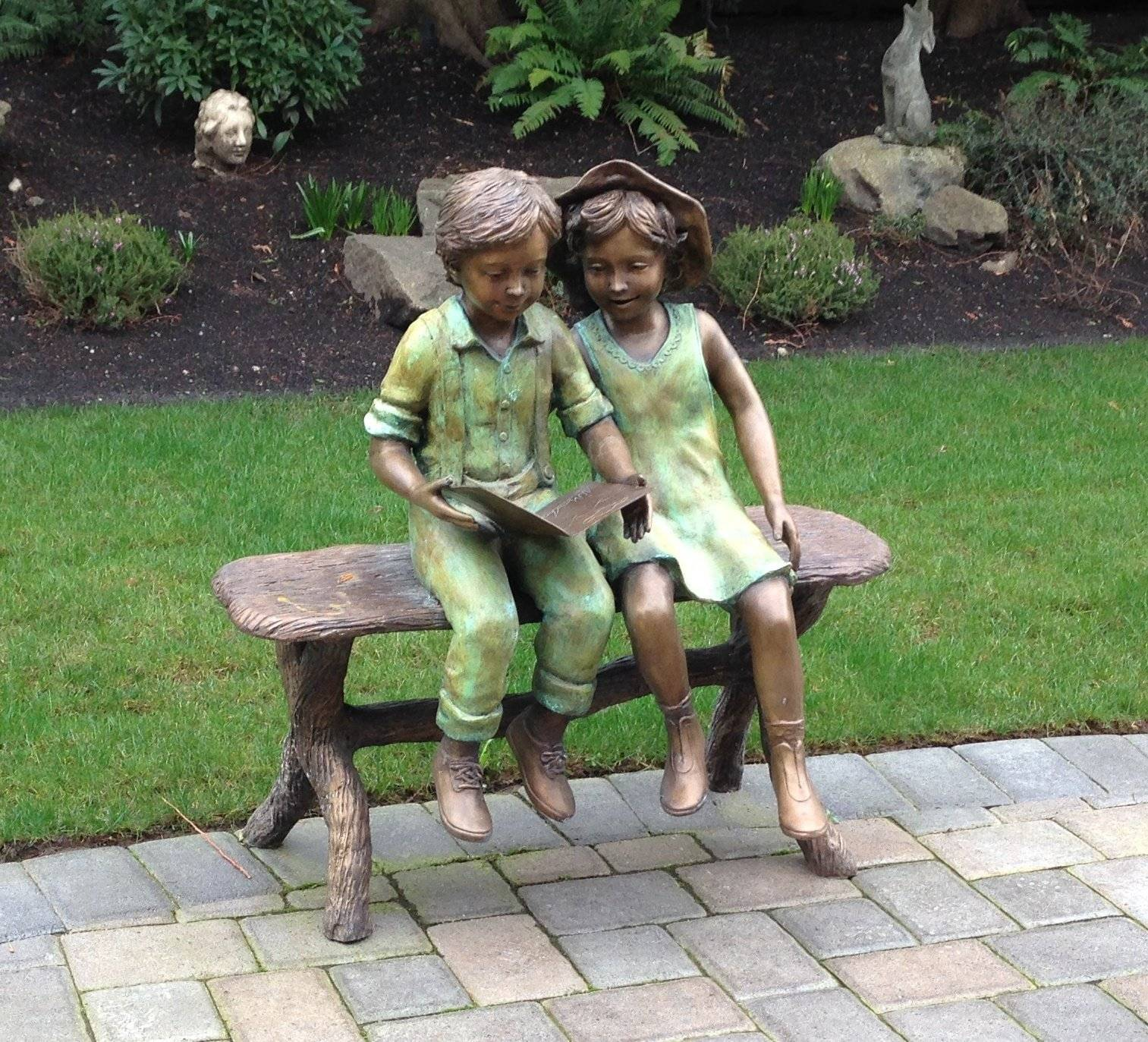Boy and Girl Reading on Bench Bronze Statue