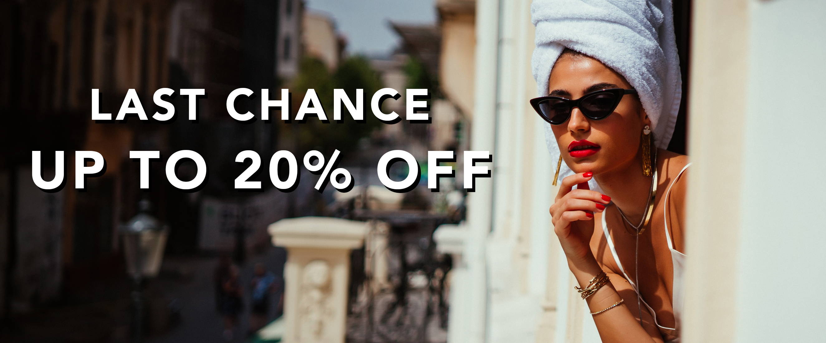 Model learning out of balcony window wearing Ring Concierge jewelry LAST CHANCE up to 20% off