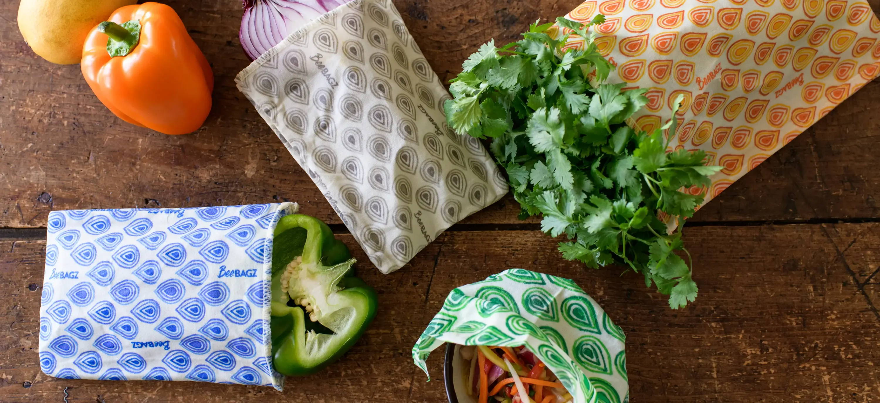 Beeswax wraps and bees wax reusable food storage bags for keeping produce fresh