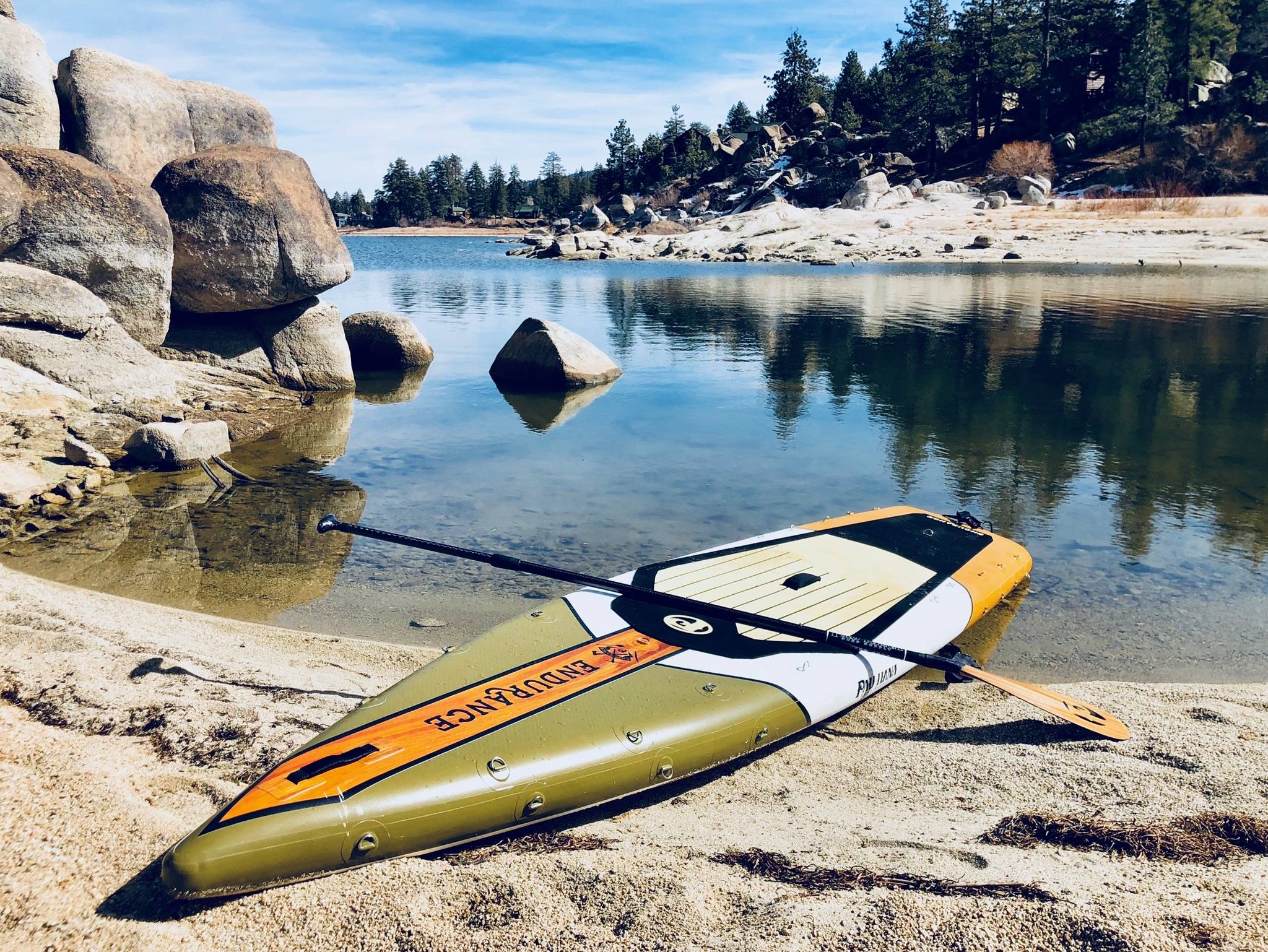 Inflatable SUP board on the lake with a paddle