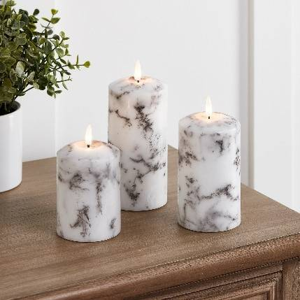 A marbled effect trio of TruGlow® flameless candles.