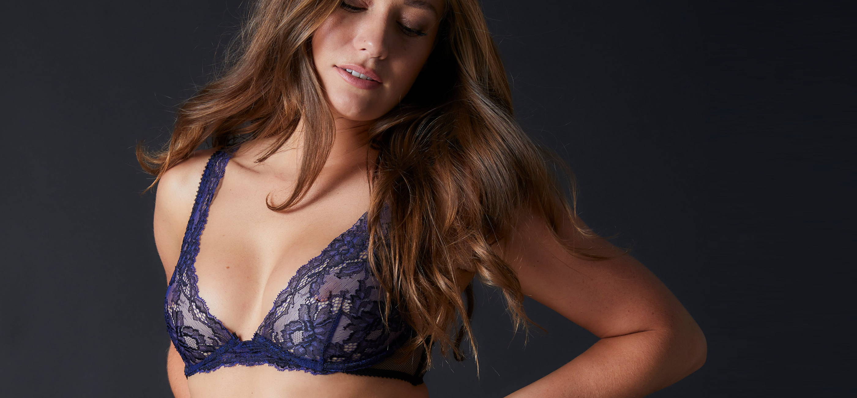 Woman wearing the lacey blue Journelle Chloe bra that is on sale for 30% off