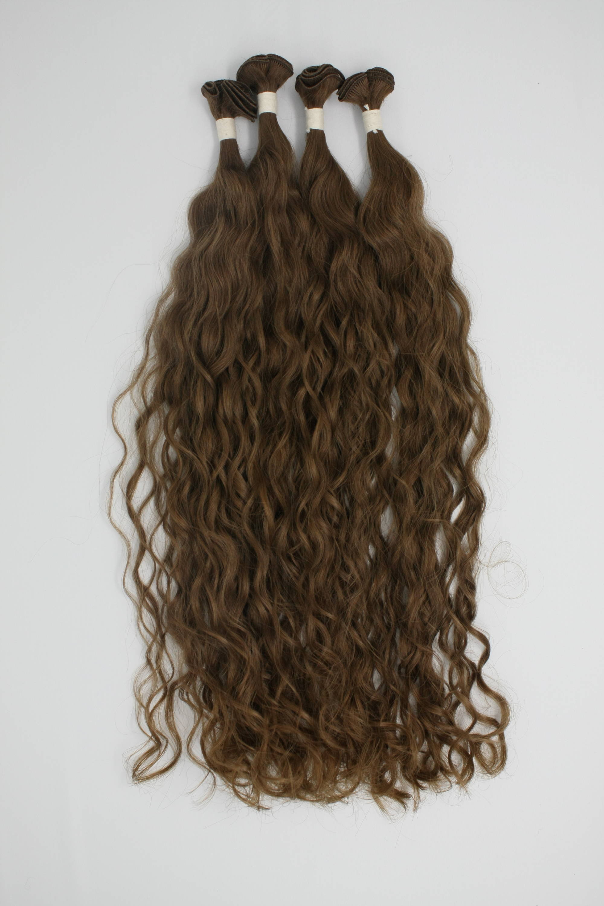 collection of Hand-tied hair extensions client who created hair extensions color using custom order
