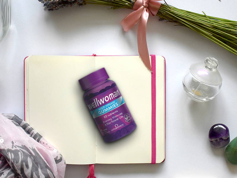 Wellwoman Gummies Product On Book