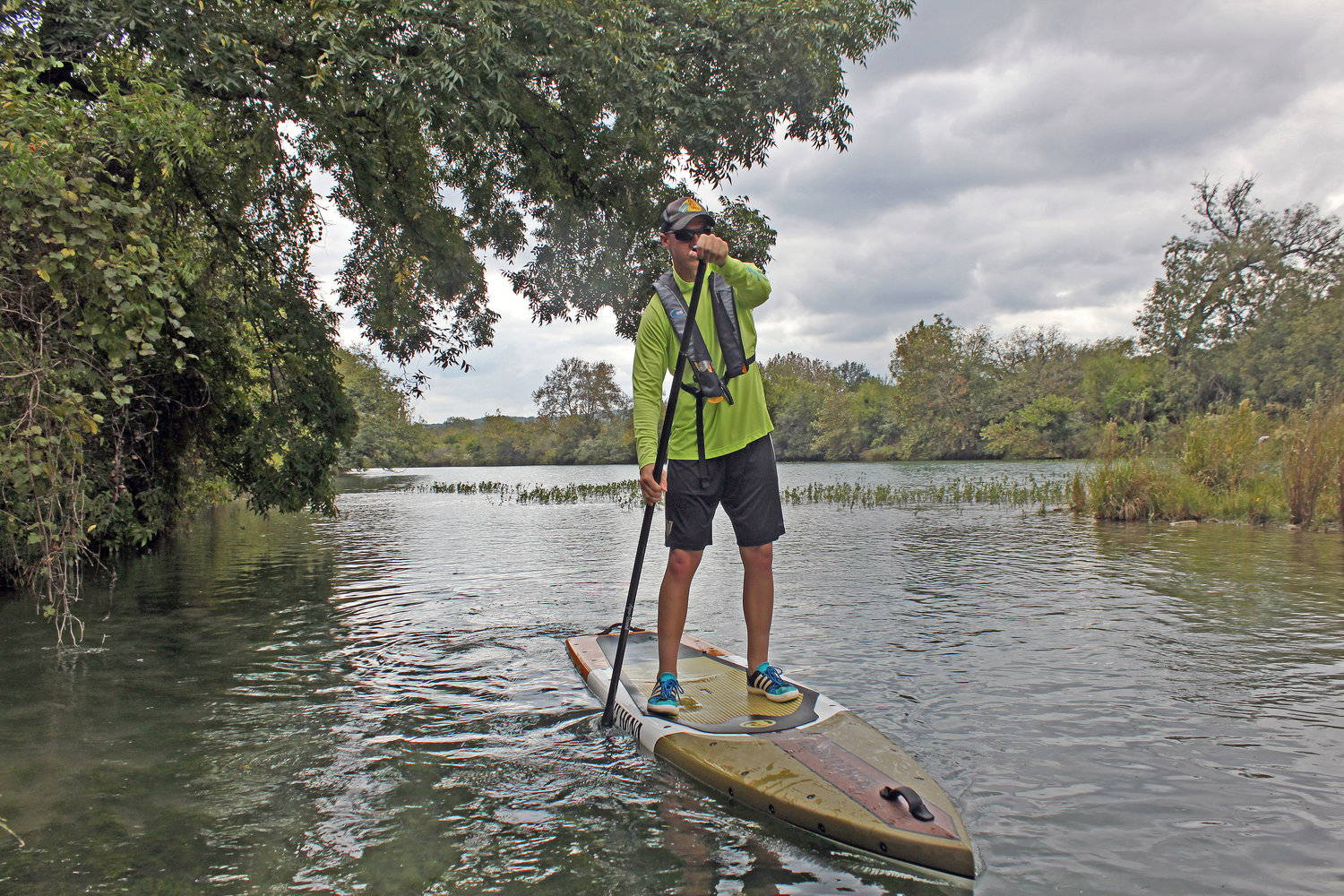 a man paddling the pau hana endurance SUP on a lake
