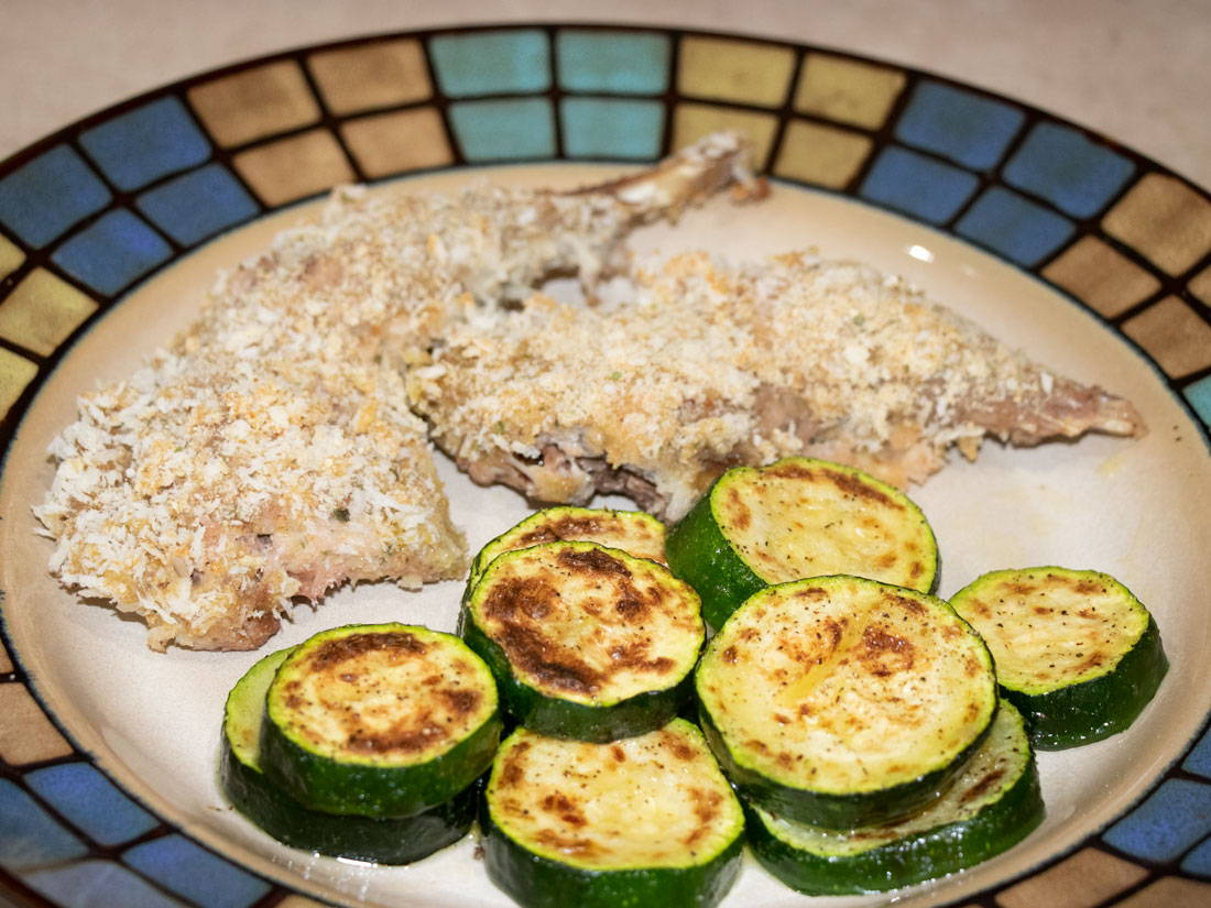 Baked pheasant and zucchini on a plate