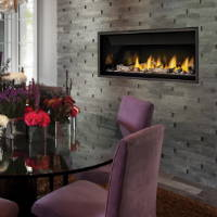 Napoleon BL46 gas fireplace in stacked stone wall
