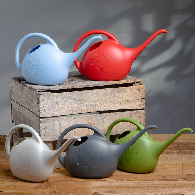 Half gallon watering cans in blue, red, white, grey and green