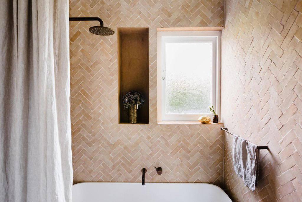 Clay Bejmat tiles in Georgia Ezra's bathroom. Photo by Amelia Stanwix.