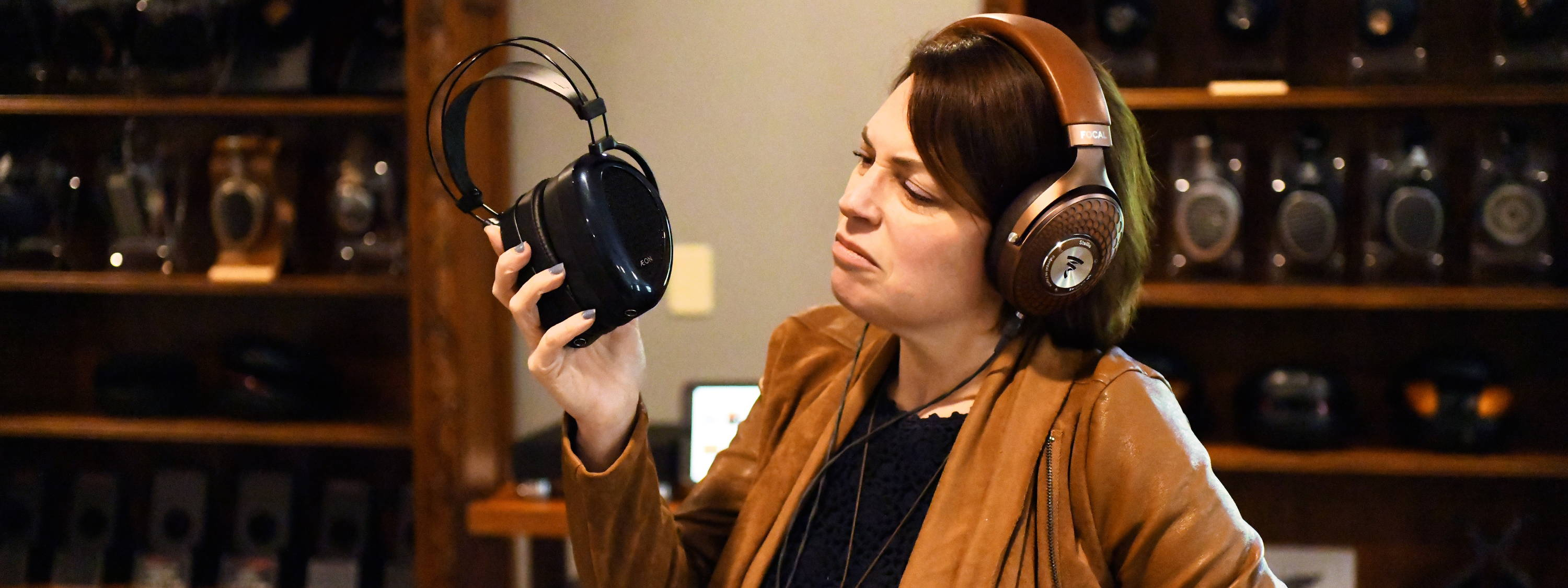 Woman looking unhappy with her headphones