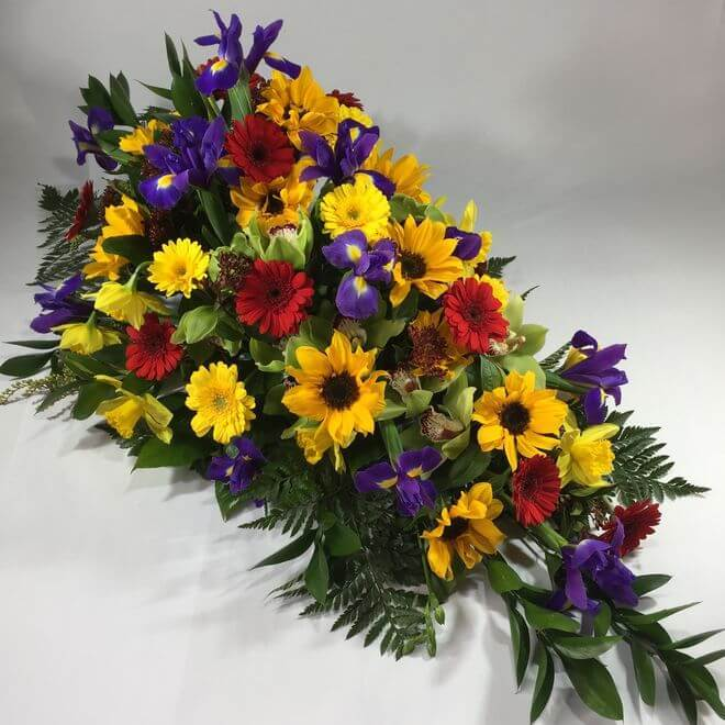 large bright coloured casket flowers