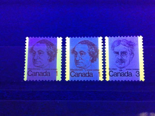 Three tagged stamps of the 1972-78 Caricature Issue of Canada, as seen under ultraviolet light